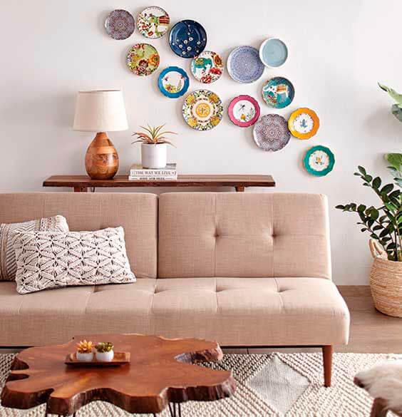 Plates on a row behind the sofa