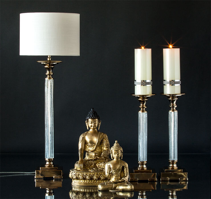 Buddha figurines with classic candlesticks and table lamps