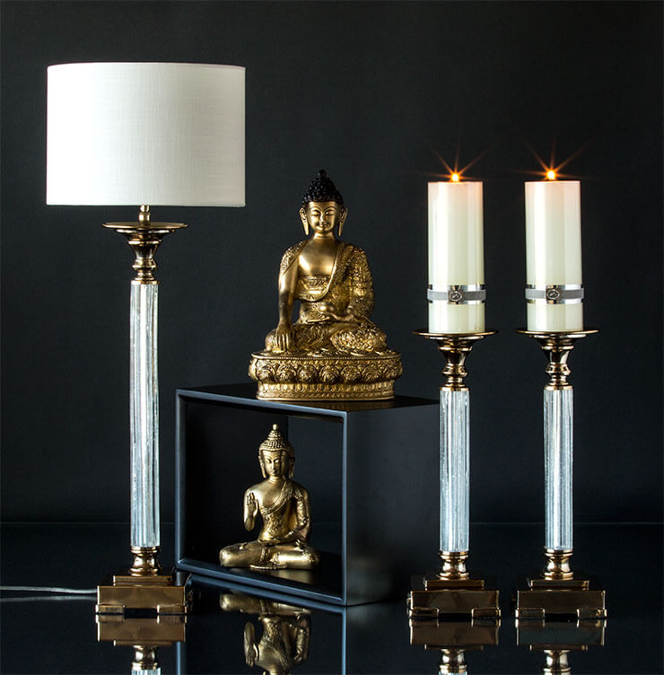 Buddha figurines and classical candleholders and Table lamp